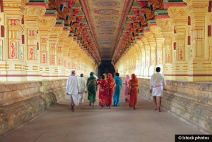 A group of Indian pilgrims going through the corridor of pillars in Ramanathaswamy Temple, biggest temple of Rameshwaram, Tamil Nadu, India