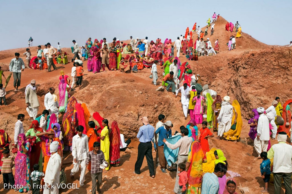 "During Jamba festival, pilgrims take sand from the lower area to enlarge the pond and build huge sand dunes near the temple as their guru told them: ""build dunes to break the wind""."